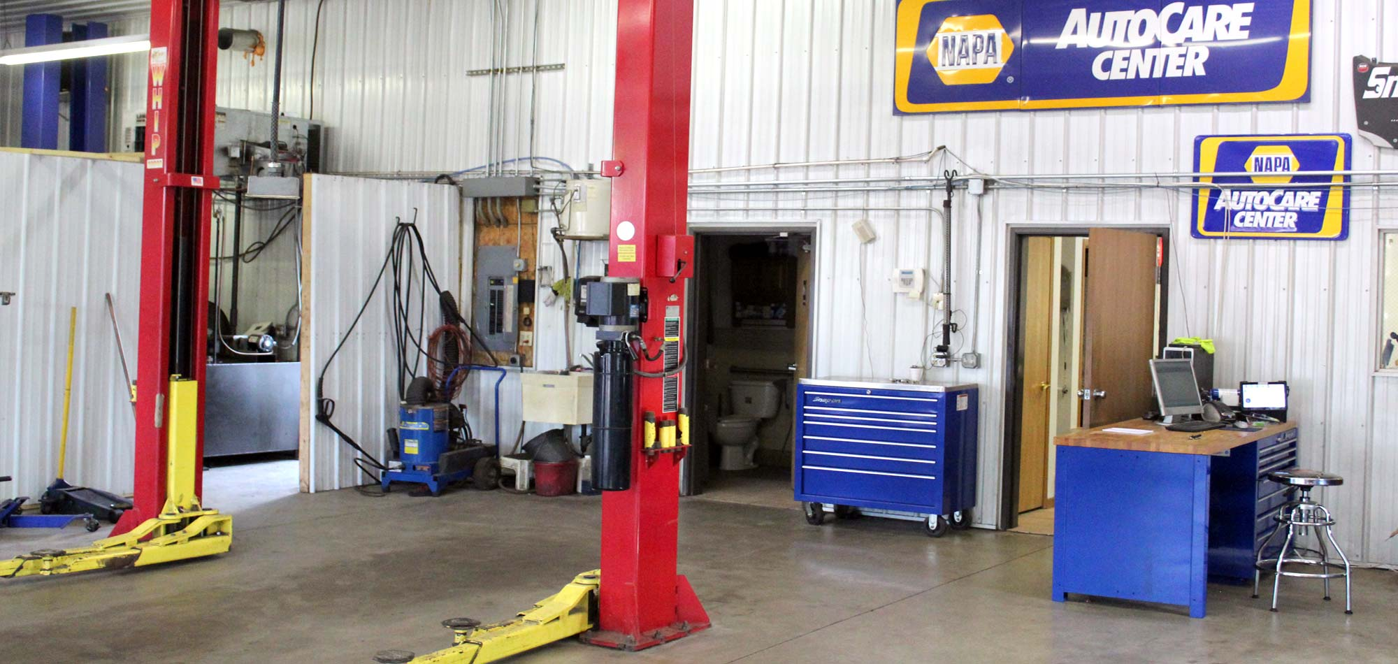 Auto lift and tools in the shop at Murphy's Auto Center